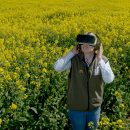 Embargoed to 0001 Friday May 6  McDonald's Progressive Young Farmer Alice Partridge, 21, wears an Oculus Virtual Reality headset in rape seed field during McDonald's Follow Our Foodsteps campaign launch at Shiplake Farm, Henley-on-Thames. PRESS ASSOCIATION Photo. Picture date: Wednesday May 4, 2016. McDonald's has partnered with tech developers, progressive young farmers and food experts from across the food and farming industries to give consumers access to parts of its famous supply chain that are usually out of reach, by using the latest virtual reality. See PA story CONSUMER McDonalds. Photo credit should read: Anthony Devlin/PA Wire